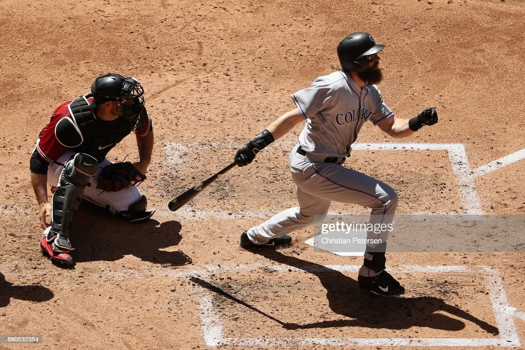 Charlie Blackmon #19 of the Colorado Rockies hits a pop fly out to right field as he bats against the Arizona Diamondbacks during the third inning of the MLB game at Chase Field on April 30, 2017 in Phoenix, Arizona. The Diamondbacks defeated the Rockies 2-0.