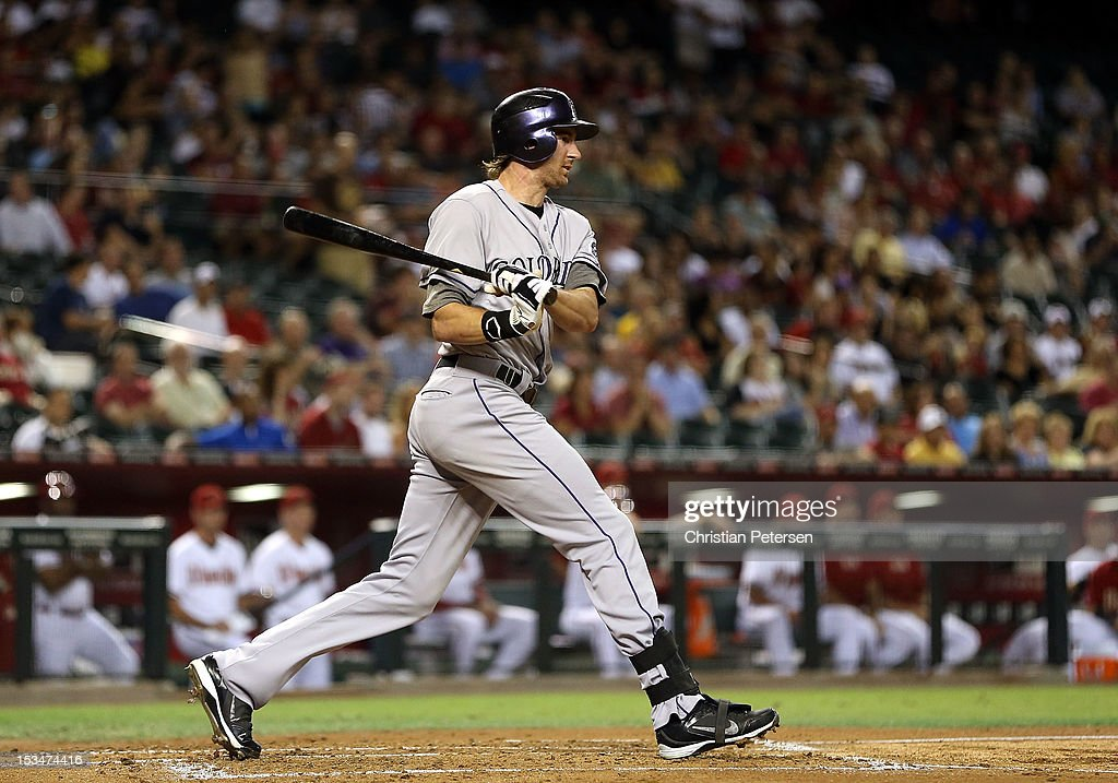Charlie Blackmon #8 of the Colorado Rockies hits a RBI on a double play fielder's choice against the Arizona Diamondbacks during the first inning of the MLB game at Chase Field on October 2, 2012 in Phoenix, Arizona.