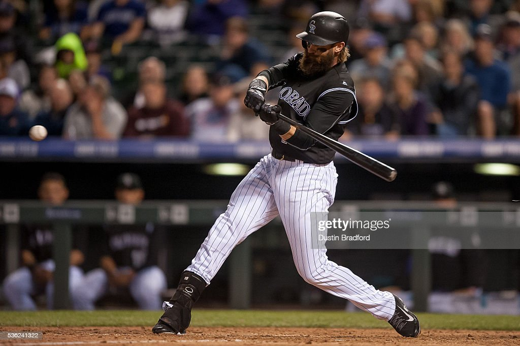 Charlie Blackmon #19 of the Colorado Rockies hits a seventh inning grand slam home run off of Dayan Diaz #50 of the Cincinnati Reds at Coors Field on May 31, 2016 in Denver, Colorado.
