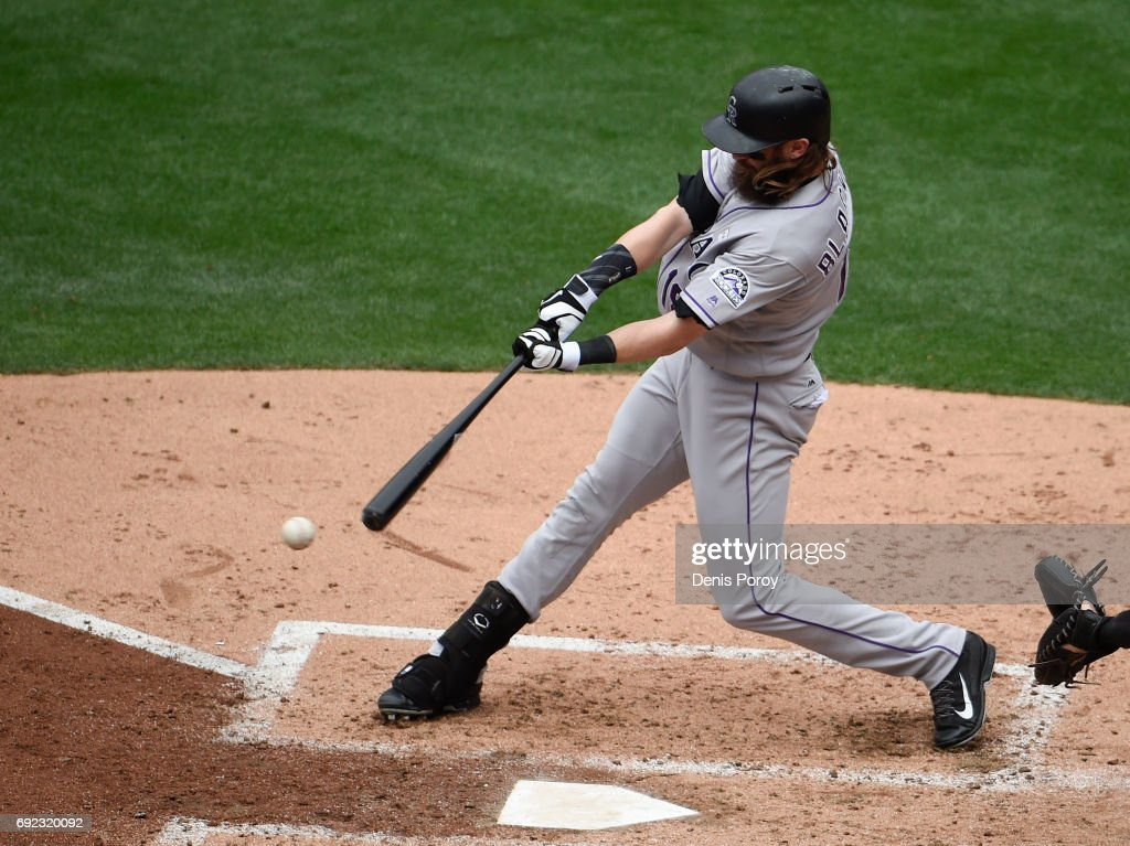 Charlie Blackmon #19 of the Colorado Rockies hits a single during the fifith inning of a baseball game against the San Diego Padres at PETCO Park on June 4, 2017 in San Diego, California.