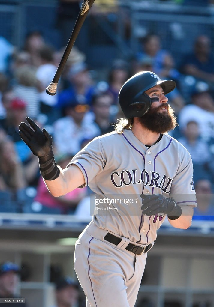 Charlie Blackmon #19 of the Colorado Rockies hits a solo home run during the ninth inning of a baseball game against the San Diego Padres at PETCO Park on September 24, 2017 in San Diego, California.