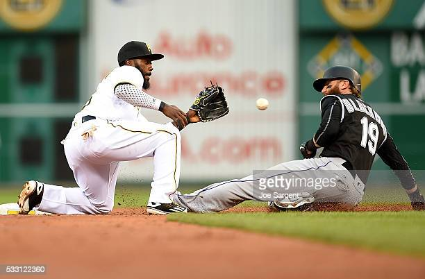 Charlie Blackmon of the Colorado Rockies is caught stealing second base in front of Josh Harrison of the Pittsburgh Pirates during the third inning...
