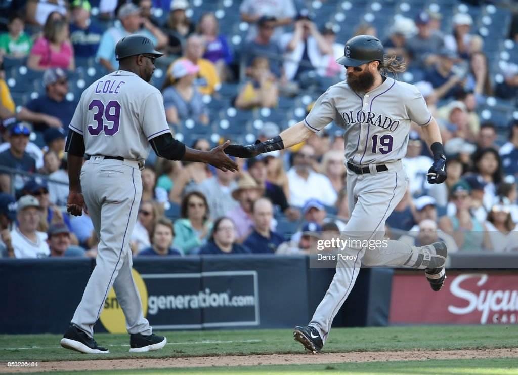 Charlie Blackmon #19 of the Colorado Rockies is congratulated by /Stu Cole #39 after hitting a solo home run during the ninth inning of a baseball game against the San Diego Padres at PETCO Park on September 24, 2017 in San Diego, California.