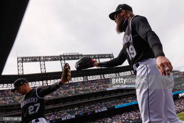 Charlie Blackmon of the Colorado Rockies is congratulated on his outfield assist to end the first inning by Trevor Story during a game against the...