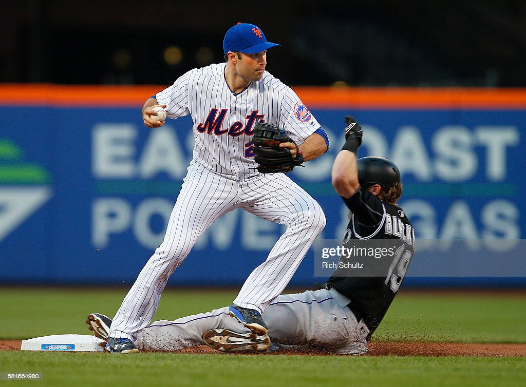 Charlie Blackmon #19 of the Colorado Rockies is forced out at second base by Neil Walker #20 of the New York Mets on a ball hit by DJ LeMahieu #9 in the first inning of a game at Citi Field on July 29, 2016 in the Flushing neighborhood of the Queens borough of New York City.