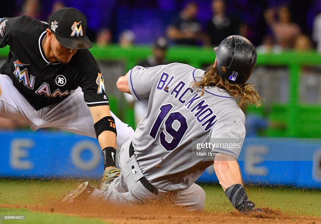 Charlie Blackmon #19 of the Colorado Rockies is tagged out at second during the game between the Miami Marlins and the Colorado Rockies at Marlins Park on August 12, 2017 in Miami, Florida.