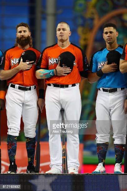 Charlie Blackmon of the Colorado Rockies Justin Bour of the Miami Marlins and Gary Sanchez of the New York Yankees look on during the National Anthem...