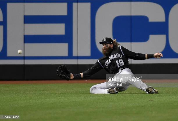Charlie Blackmon of the Colorado Rockies makes a diving catch in center field against the Arizona Diamondbacks during the second inning at Chase...