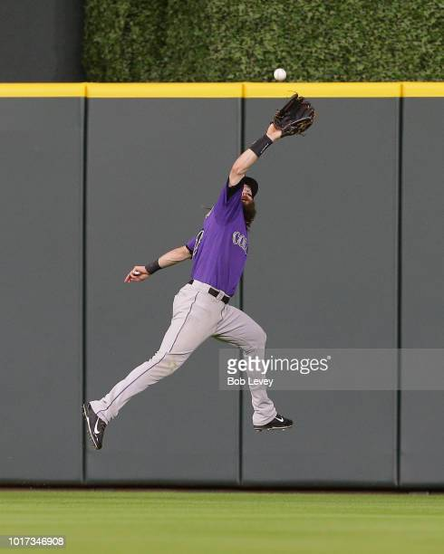 Charlie Blackmon of the Colorado Rockies makes a running catch on a line drive by Alex Bregman of the Houston Astros in the second inning at Minute...