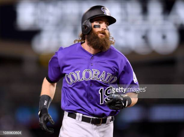 Charlie Blackmon of the Colorado Rockies reacts as he runs the bases after his solo homerun to take a 21 lead over the Los Angeles Dodgers during the...
