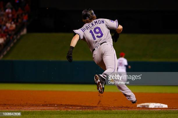 Charlie Blackmon of the Colorado Rockies rounds first base after hitting a tworun home run against the St Louis Cardinals in the fifth inning at...