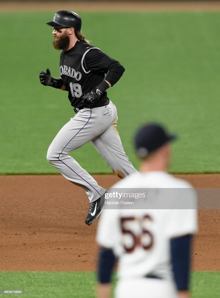 Charlie Blackmon #19 of the Colorado Rockies rounds the bases after hitting a two-run home run as Tyler Duffey #56 of the Minnesota Twins looks on during the sixth inning of the game on May 16, 2017 at Target Field in Minneapolis, Minnesota. The Rockies defeated the Twins 7-3.