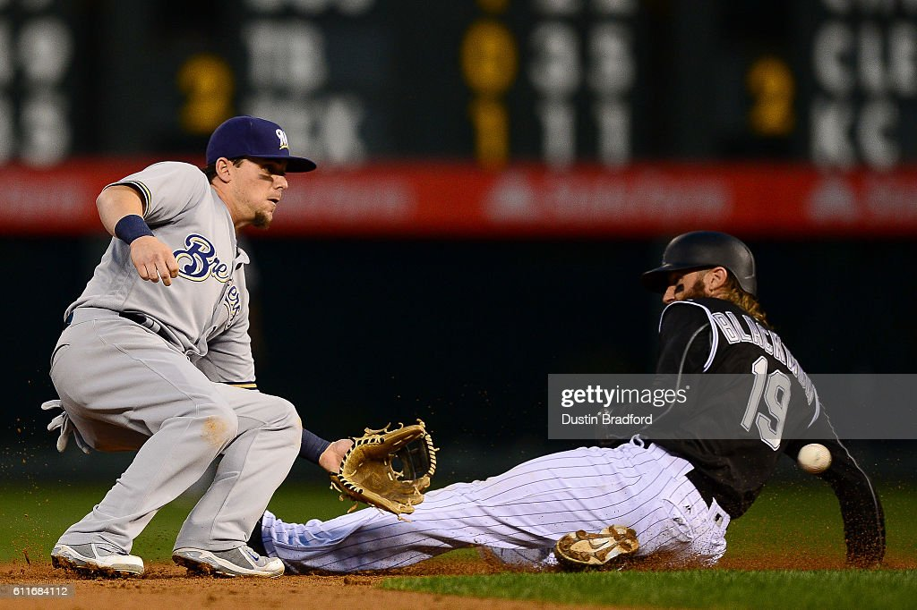 Charlie Blackmon #19 of the Colorado Rockies slides into second base before being tagged out by Scooter Gennett #2 of the Milwaukee Brewers on a play that was overturned on manager's review in the second inning of a game at Coors Field on September 30, 2016 in Denver, Colorado.