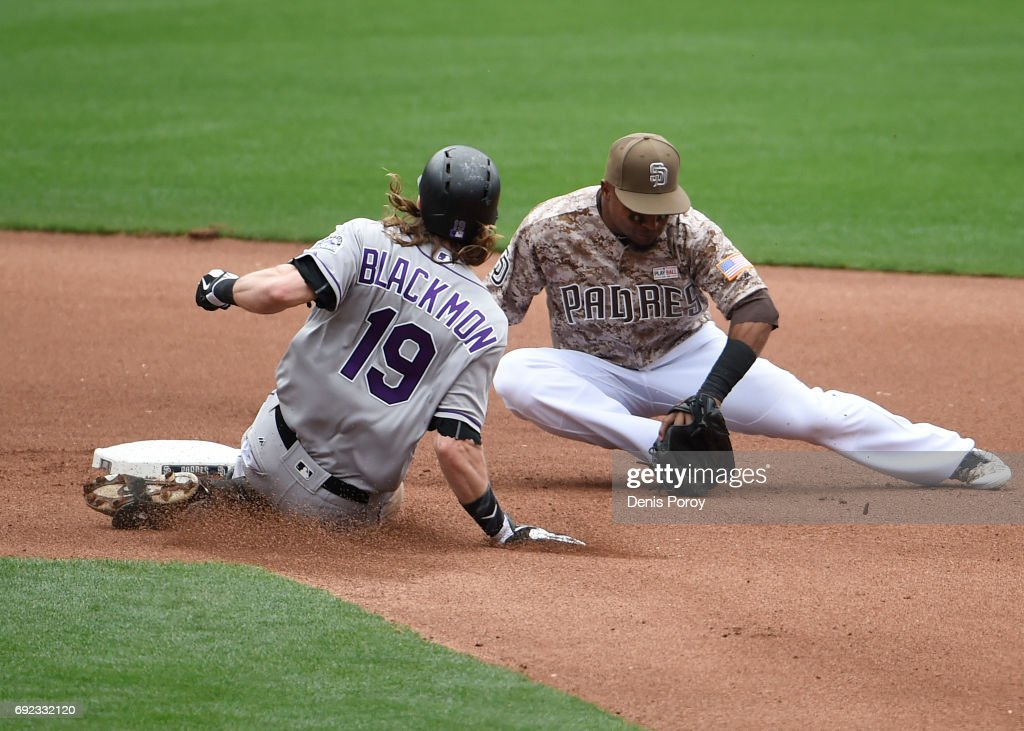 Charlie Blackmon #19 of the Colorado Rockies slides into second base with a double ahead of the tag of Erick Aybar #8 of the San Diego Padres during the seventh inning of a baseball game at PETCO Park on June 4, 2017 in San Diego, California.