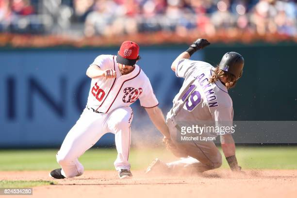 Charlie Blackmon of the Colorado Rockies steals second base on throw to Daniel Murphy of the Washington Nationals in the eight inning during game one...