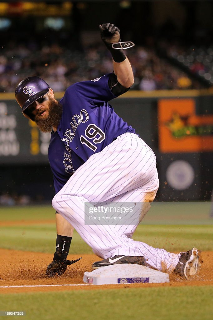 Charlie Blackmon #19 of the Colorado Rockies steals third base against the Pittsburgh Pirates at Coors Field on September 21, 2015 in Denver, Colorado. The Pirates defeated the Rockies 9-3.