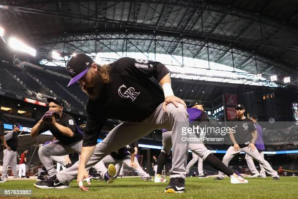 Charlie Blackmon of the Colorado Rockies stretches before the start of the National League Wild Card game against the Arizona Diamondbacks at Chase...