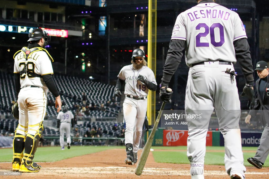 Charlie Blackmon #19 of the Colorado Rockies touches home plate after on his solo home run in the eighth inning against the Pittsburgh Pirates at PNC Park on April 16, 2018 in Pittsburgh, Pennsylvania.