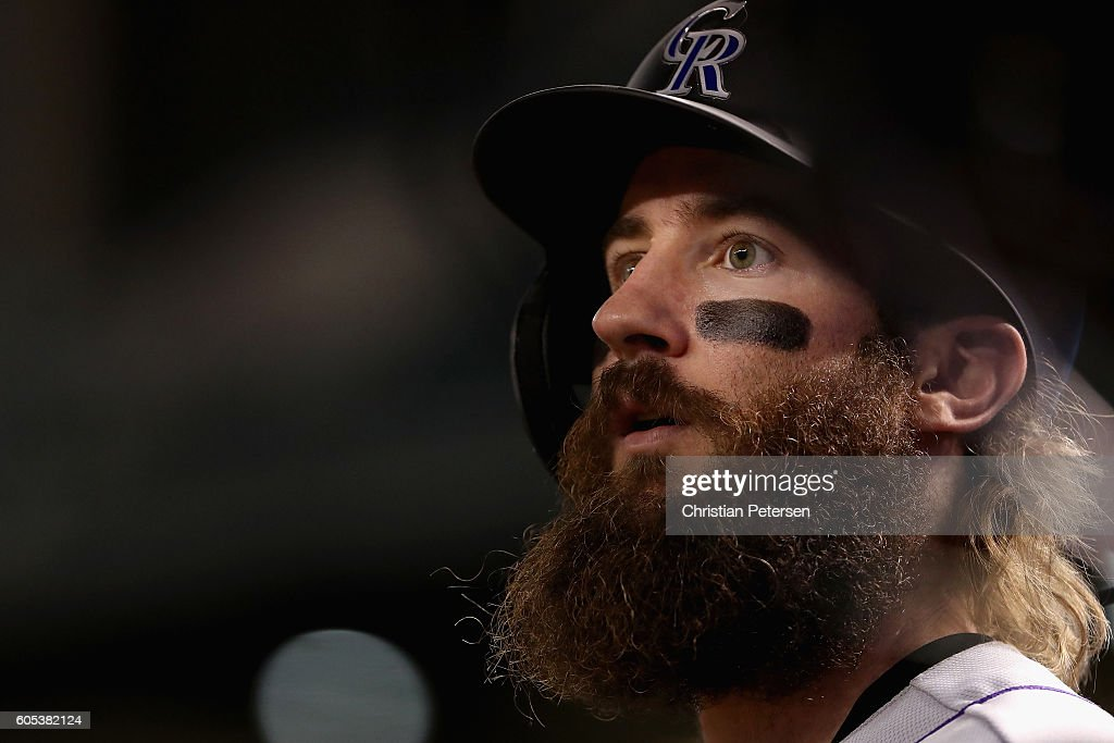 Charlie Blackmon #19 of the Colorado Rockies watches from the dugout during the MLB game against the Arizona Diamondbacks at Chase Field on September 13, 2016 in Phoenix, Arizona.