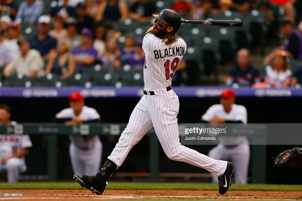 Charlie Blackmon #19 of the Colorado Rockies watches his solo home run during the first inning against the San Francisco Giants at Coors Field on July 3, 2018 in Denver, Colorado.