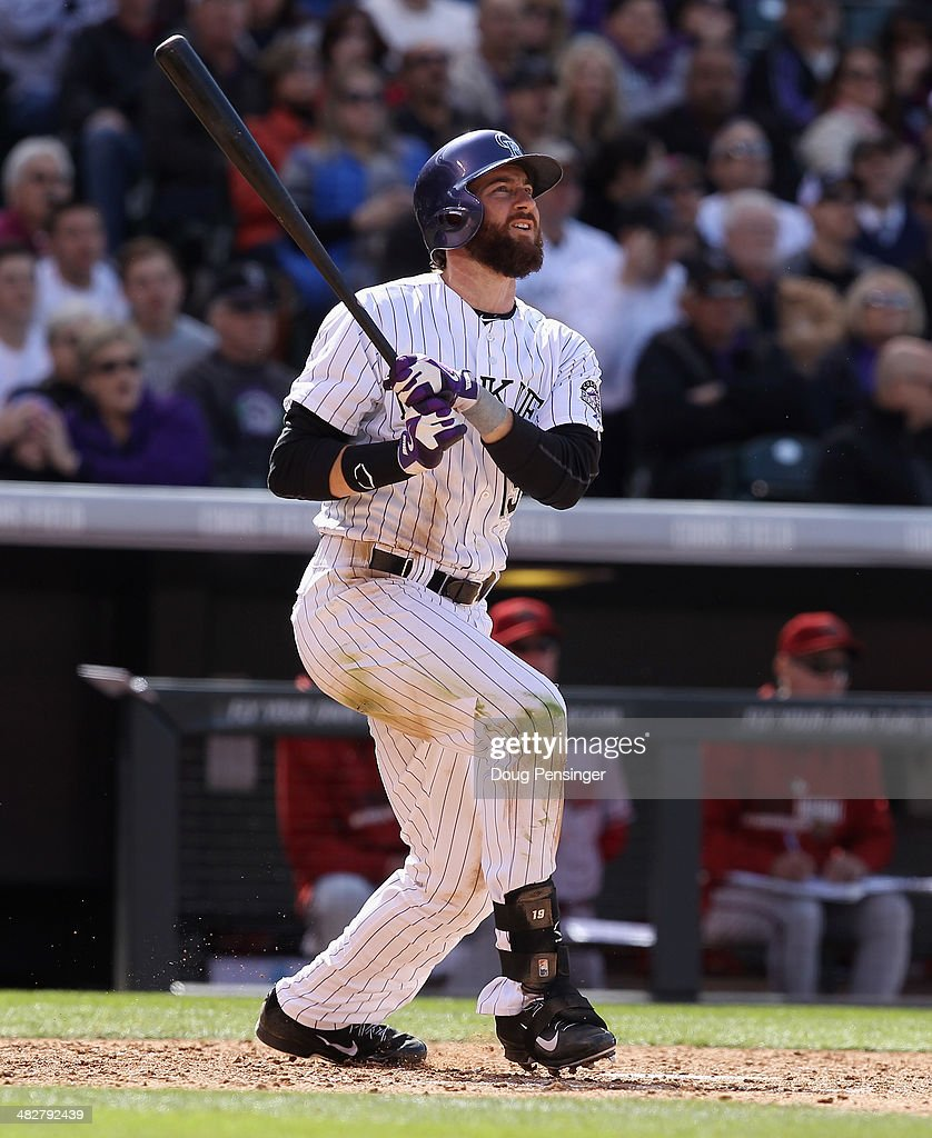 Charlie Blackmon #19 of the Colorado Rockies watches his two run homerun off of Randall Delgado #48 of the Arizona Diamondbacks to give the Rockies a 6-0 lead in the fourth inning during the home opener at Coors Field on April 4, 2014 in Denver, Colorado. Blackmon went six for six as the Rockies defeated the Diamondbacks 12-2.