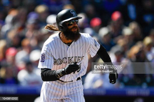 Charlie Blackmon of the Colorado Rockies watches the flight of a third inning tworun homerun against the Washington Nationals at Coors Field on...