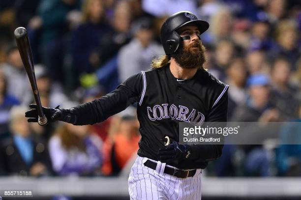 Charlie Blackmon of the Colorado Rockies watches the flight of second inning 2run homerun against the Los Angeles Dodgers during a game at Coors...