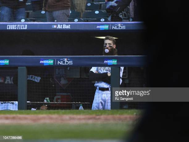 Charlie Blackmon of the Colorado Rockies watches the Milwaukee Brewers  celebrate after the Rockies lost Game