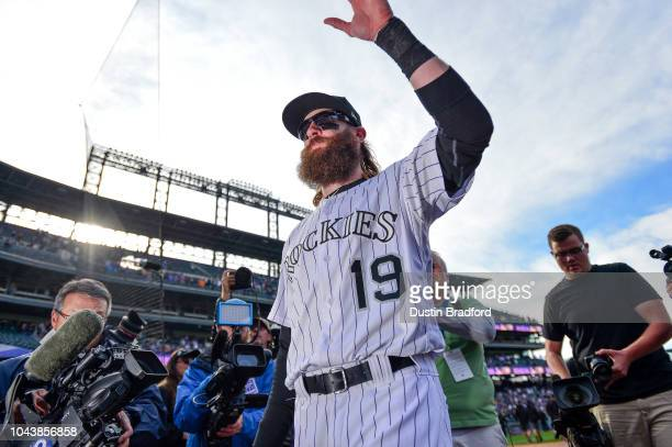 Charlie Blackmon of the Colorado Rockies waves to the crowd after walking around the field for fan appreciation after a 122 win over the Washington...