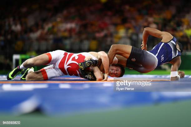 Charlie Bowling of England and Jean Guyliane Bandou of Mauritius compete during the Men's Freestyle 65 kg Bronze match on day nine of the Gold Coast...