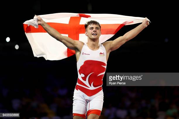 Charlie Bowling of England celebrates victory over Jean Guyliane Bandou of Mauritius in the Men's Freestyle 65 kg Bronze match on day nine of the...