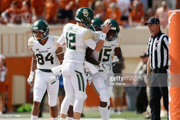 Charlie Brewer of the Baylor Bears congratulates Denzel Mims of the Baylor Bears after a touchdown in the first half against the Texas Longhorns at...