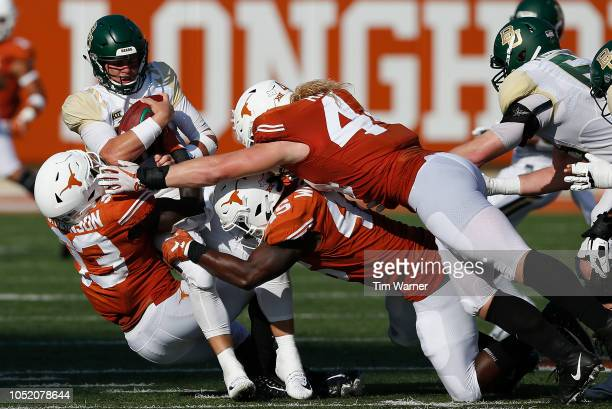 Charlie Brewer of the Baylor Bears is sacked by Gary Johnson of the Texas Longhorns and Anthony Wheeler in the second half at Darrell K Royal-Texas...