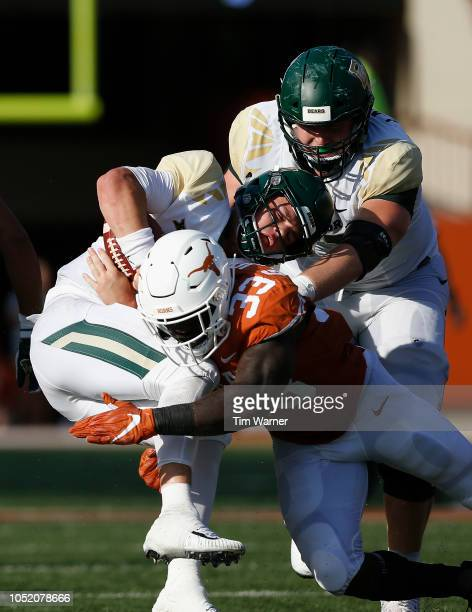 Charlie Brewer of the Baylor Bears is sacked by Gary Johnson of the Texas Longhorns in the second half at Darrell K RoyalTexas Memorial Stadium on...