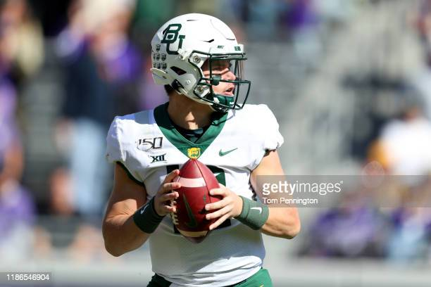 Charlie Brewer of the Baylor Bears looks for an open receiver in the first quarter against the TCU Horned Frogs at Amon G Carter Stadium on November...