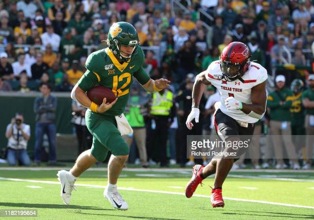 Charlie Brewer of the Baylor Bears runs the ball as he is pursued by Jordyn Brooks of the Texas Tech Red Raiders on October 12 2019 in Waco Texas