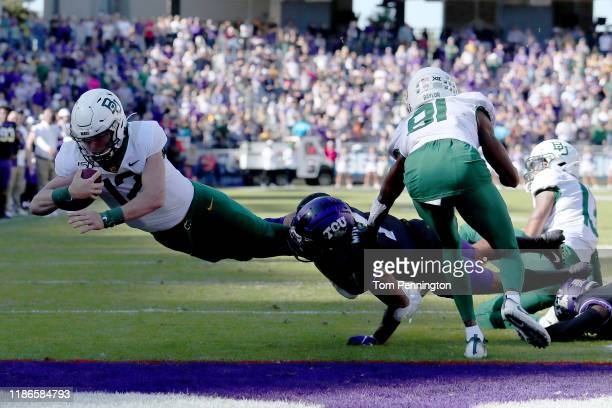 Charlie Brewer of the Baylor Bears scores a touchdown against the TCU Horned Frogs in the second overtime period at Amon G. Carter Stadium on...