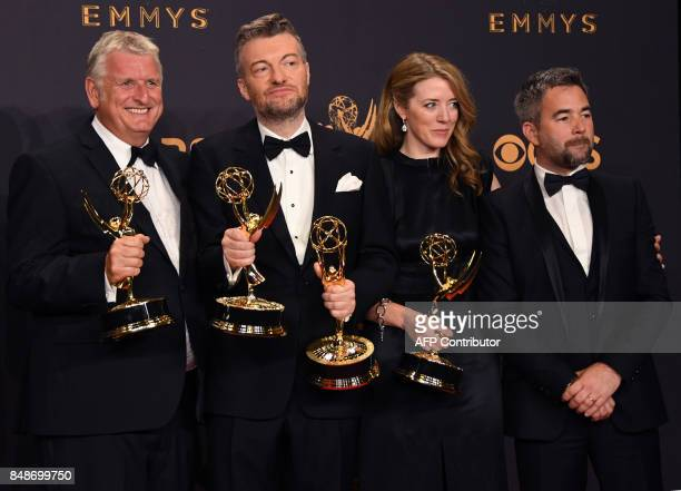 Charlie Brooker and the 'Black Mirror' crew pose with the Emmy for Outstanding Writing for a Limited Series Movie or Dramatic Special during the 69th...