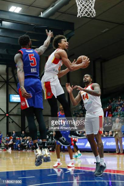 Charlie Brown Jr #2 of the College Park Skyhawks goes to the basket against Donta Hall of the Grand Rapids Drive during the first half of an NBA...