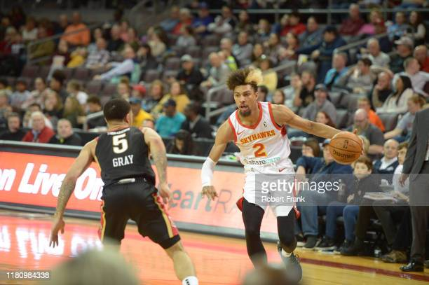 Charlie Brown Jr #2 of the College Park SkyHawks looks to drive past Josh Gray of the Erie BayHawks during a G League game between the Erie BayHawks...