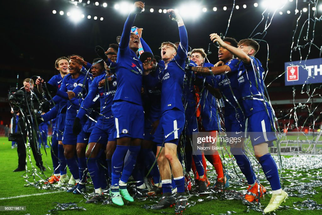 Charlie Brown (center) of Chelsea FC celebrates with his teammates after they win the FA Youth Cup Final, second leg match between Arsenal and Chelsea at Emirates Stadium on April 30, 2018 in London, England.