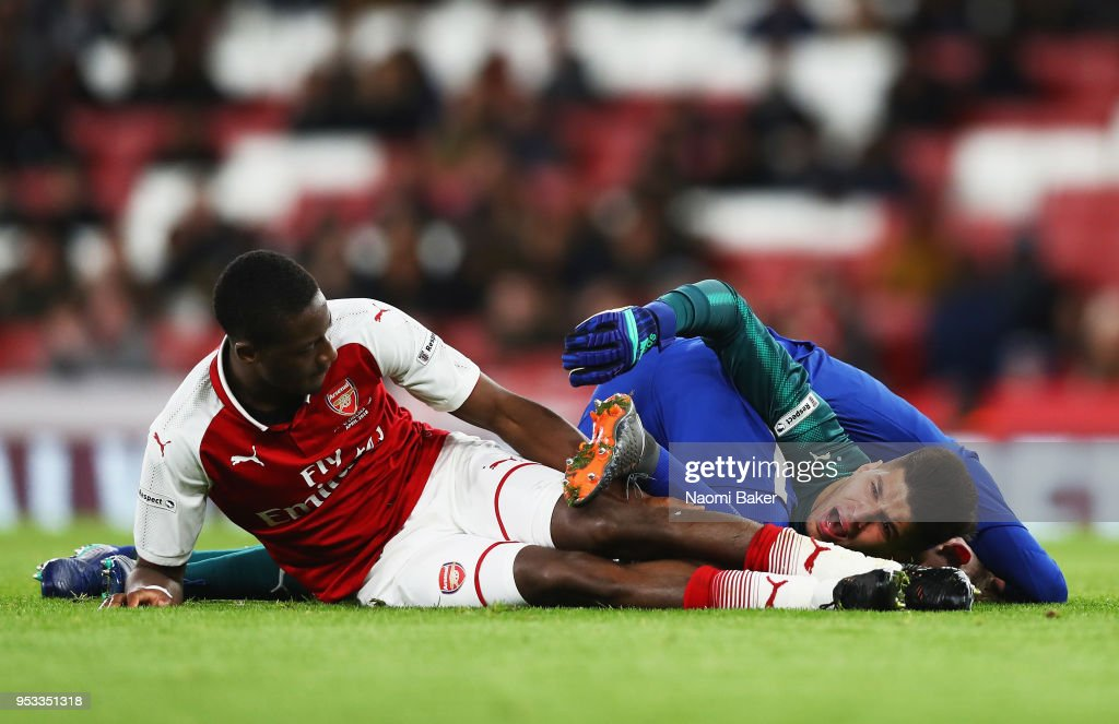 Charlie Brown of Chelsea FC collides with Joseph Olowu of Arsenal FC and Joao Virginia of Arsenal FC during the FA Youth Cup Final, second leg match between Arsenal and Chelsea at Emirates Stadium on April 30, 2018 in London, England.