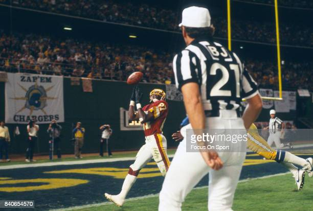 Charlie Brown of the Washington Redskins can't hold onto this pass while covered by Danny Walters of the San Diego Chargers during an NFL football...