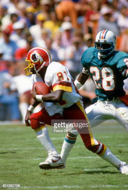 83ce7ecd852 Charlie Brown of the Washington Redskins runs with the ball after catching  a pass against the