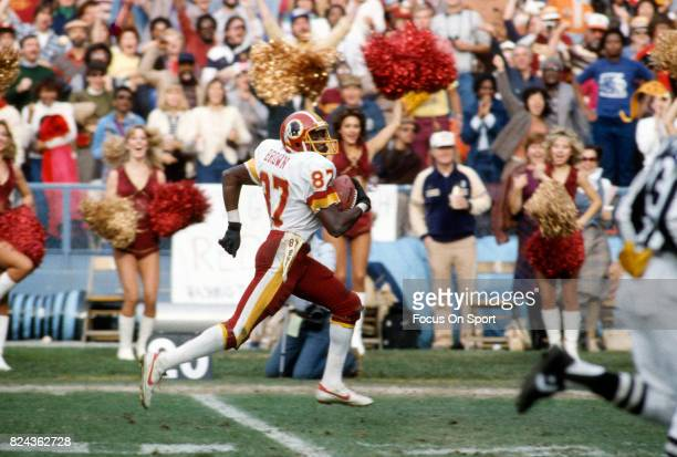 e745814adc6 Charlie Brown of the Washington Redskins runs with the ball during an NFL  football game circa