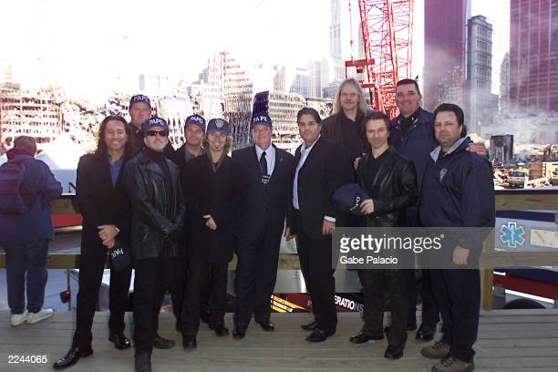 Charlie Brusco of TBA Entertainment Band members from Styx and Journey toured Ground Zero of the World Trade Center and presented a check for half a...
