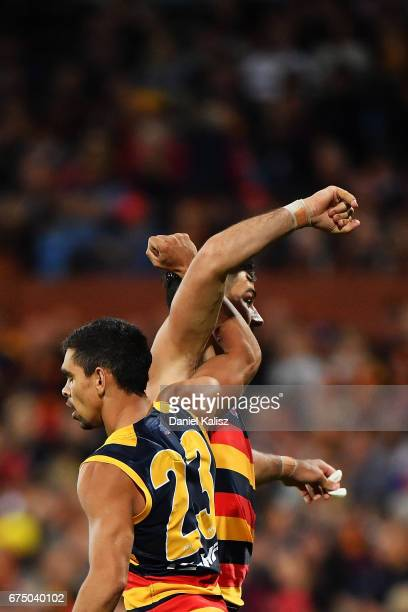 Charlie Cameron and Taylor Walker of the Crows react during the round six AFL match between the Adelaide Crows and the Richmond Tigers at Adelaide...