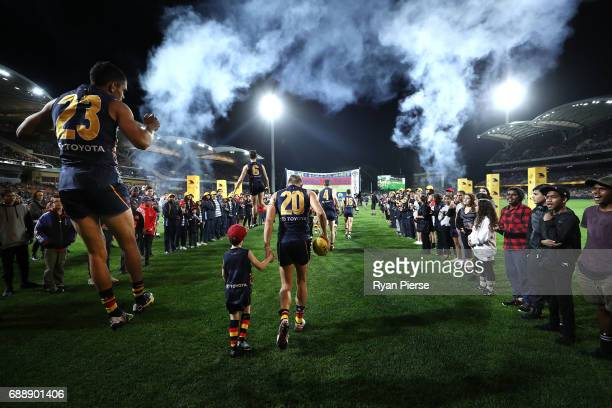 Charlie Cameron of the Crows runs out onto the ground during the round 10 AFL match between the Adelaide Crows and the Fremantle Dockers at Adelaide...