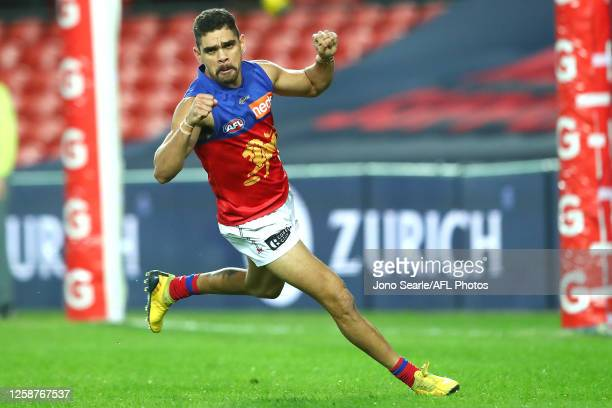 Charlie Cameron of the Lions celebrates a goal during the round 8 AFL match between the Melbourne Demons and the Brisbane Lions at Metricon Stadium...