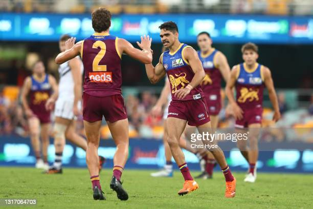 Charlie Cameron of the Lions celebrates a goal during the round eight AFL match between the Fremantle Dockers and the Brisbane Lions at The Gabba on...